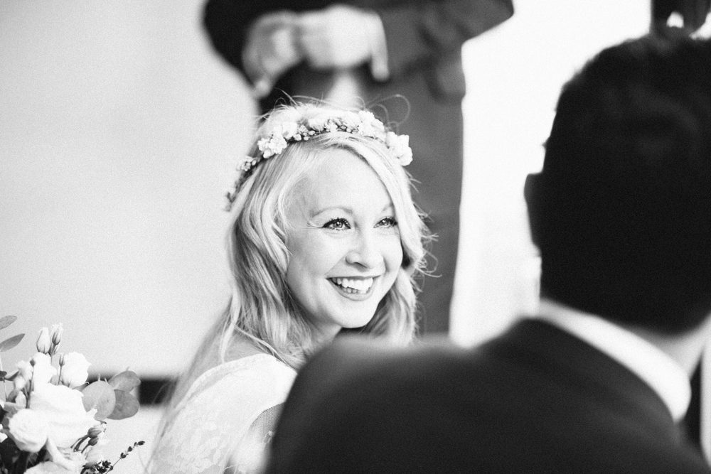 bnw bride looking lovingly groom reportage wedding photographer