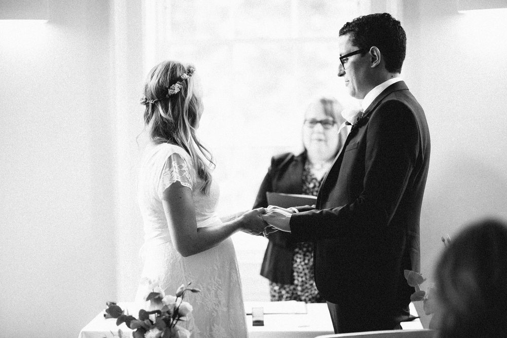 exchanging of rings Clissold House wedding ceremony boho bride