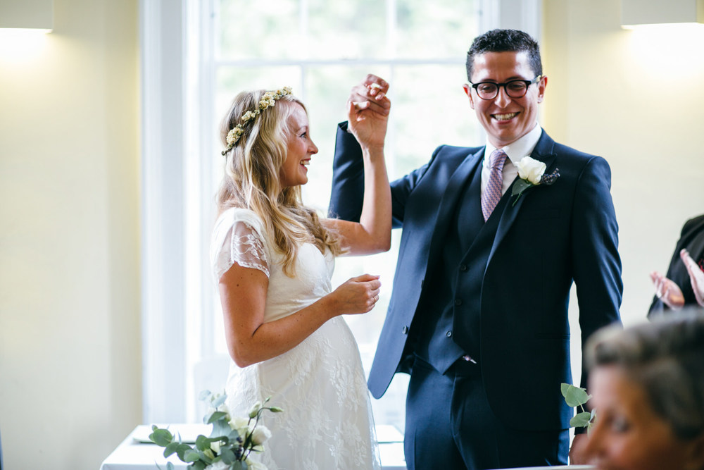 ecstatic newly married bride groom Clissold House wedding ceremony