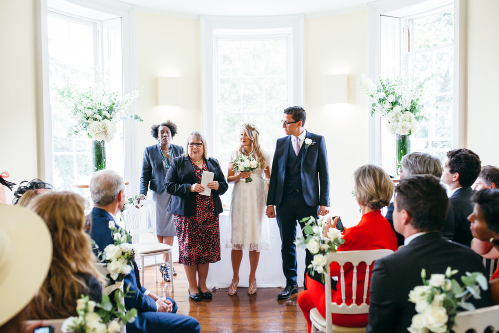 bride receiving wedding certificate Clissold House wedding photos
