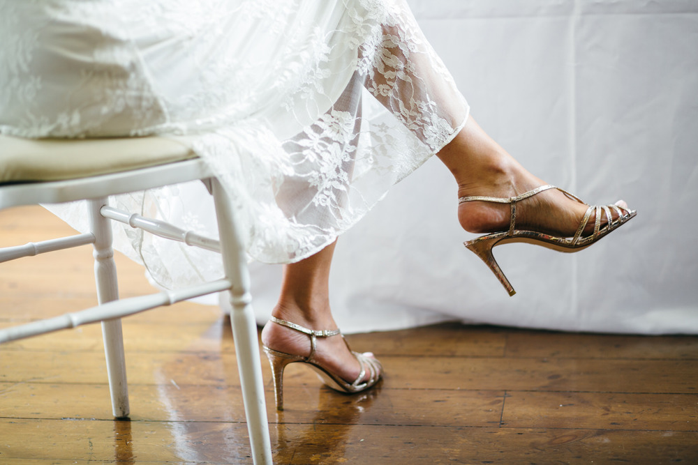 photo of boho bride silver wedding sandals