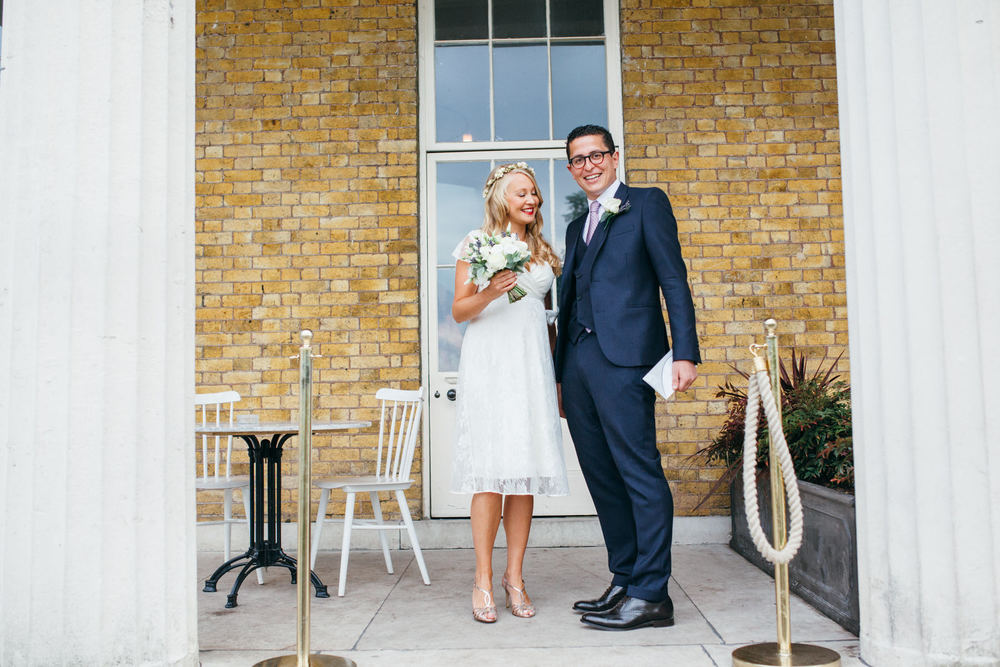bride exits Clissold House with groom