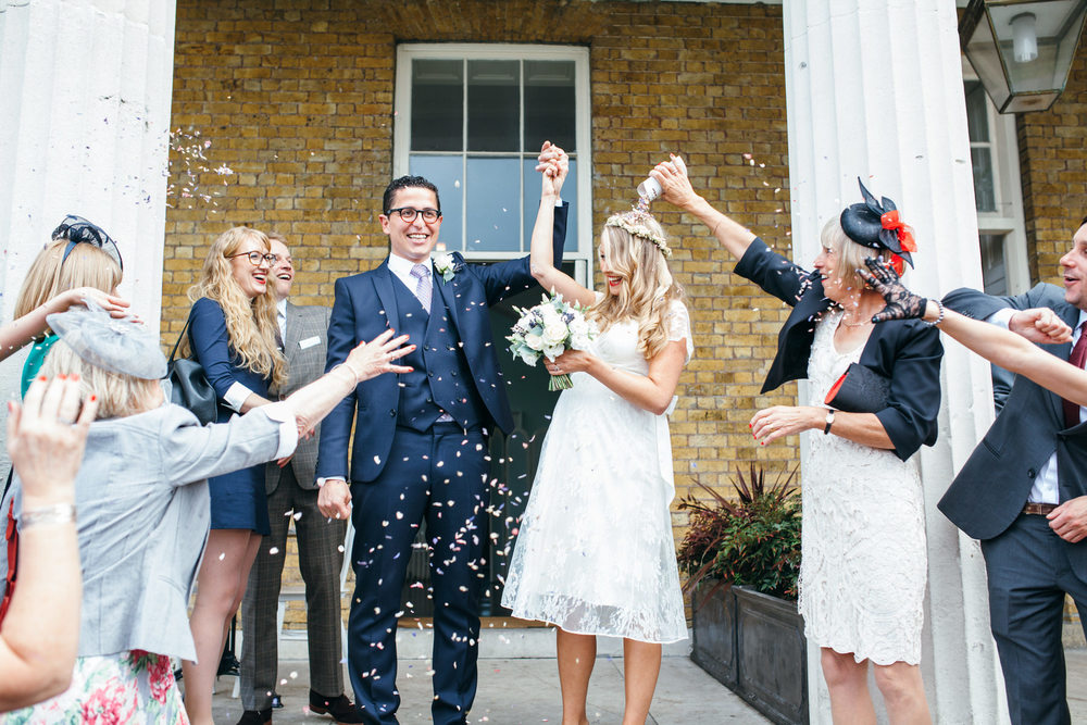 confetti on steps Clissold House relaxed summer wedding