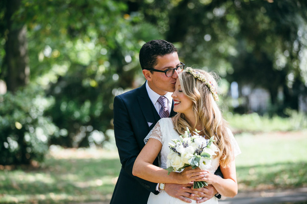 groom kissing bride forehead Stoke Newington wedding photographer