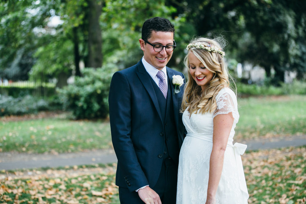 relaxed boho bride having intimate moment Clissold park