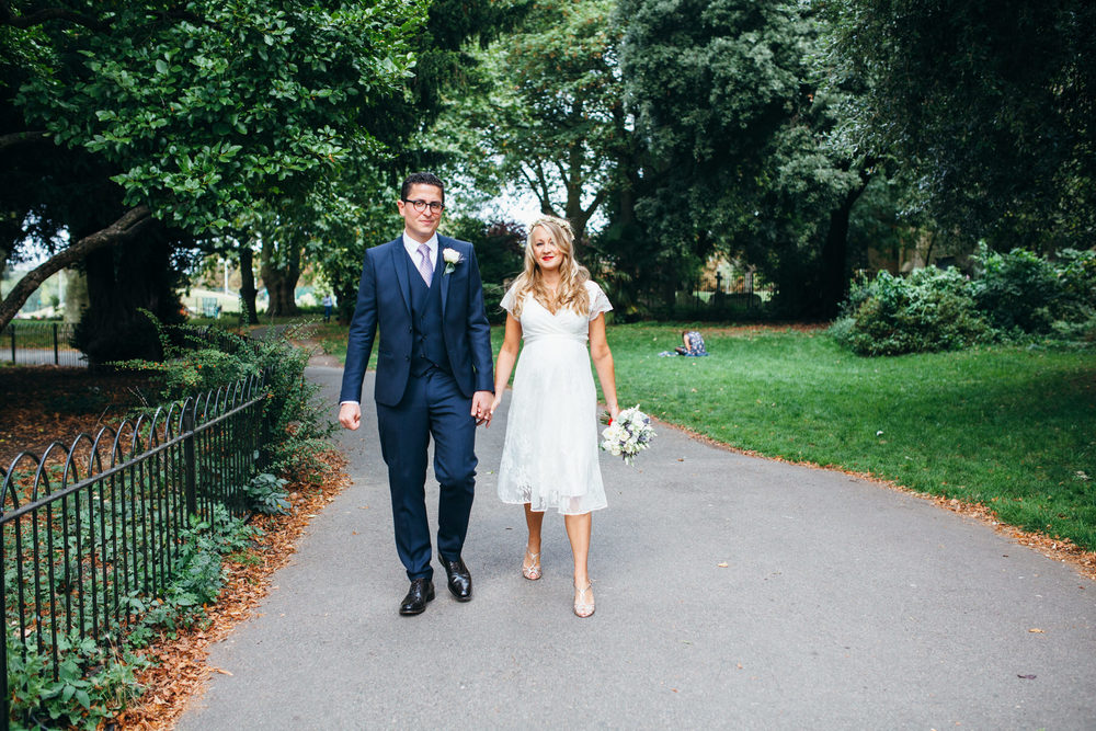newly married couple walking through Clissold Park Stoke Newington