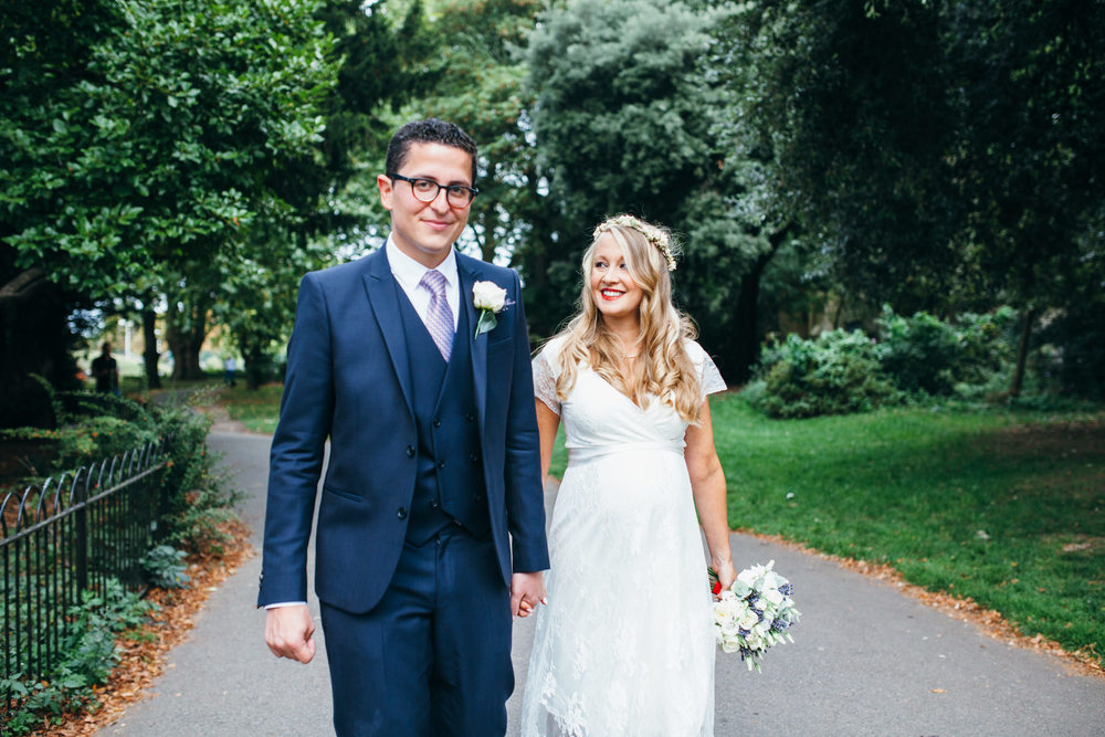 happy couple portrait walking London reportage wedding photography