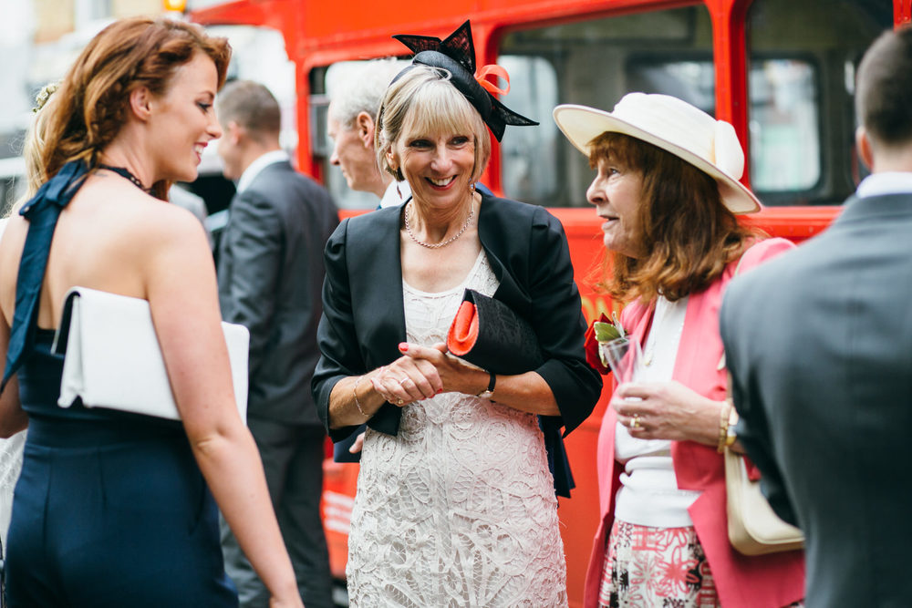 mother of bride arriving red wedding bus London