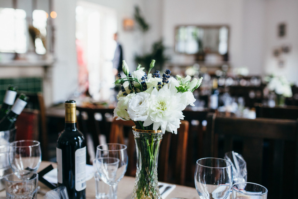 white roses on tables The Stag pub wedding venue