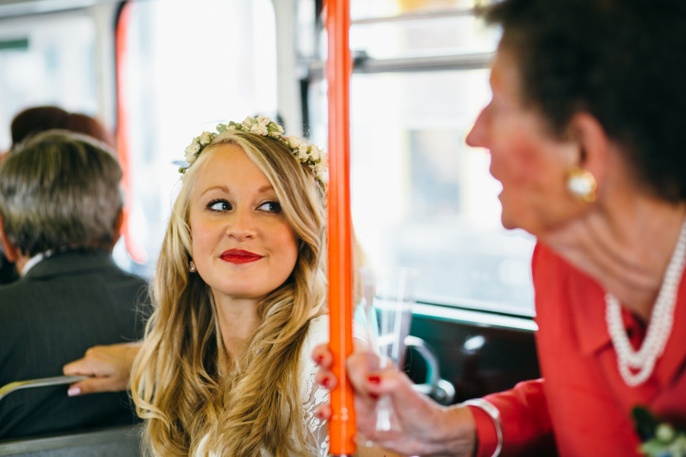 bride on London wedding transport red bus hire