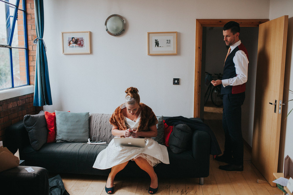 bride getting ready with groom before wedding ceremony London