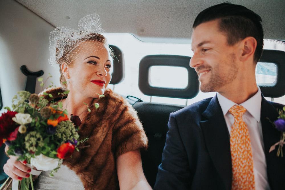 groom bride birdcage veil London black cab