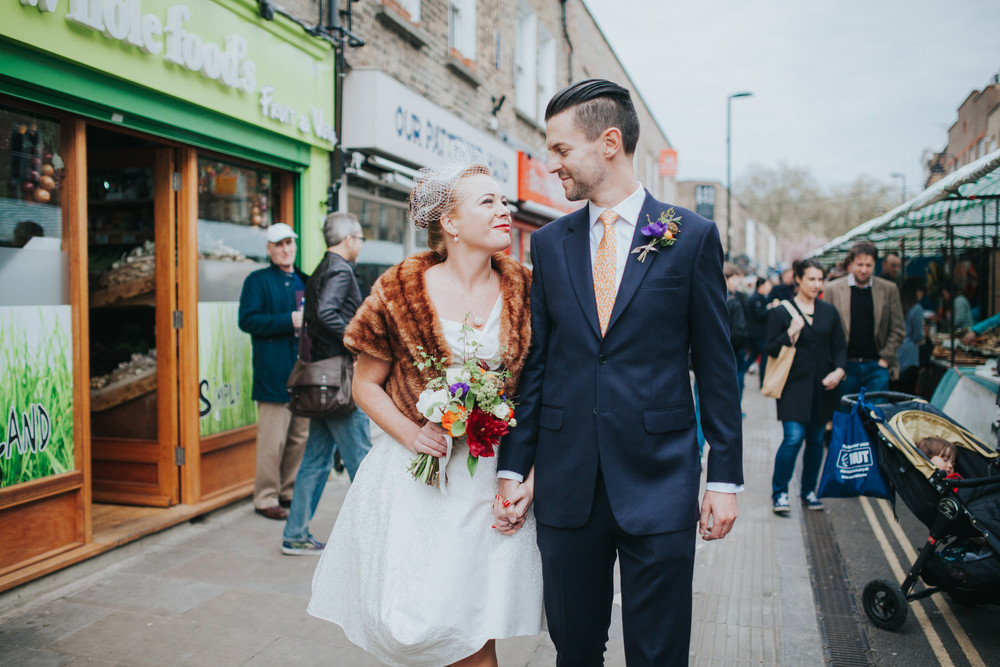 MS-Londesborough-Pub-wedding-Hackney-alternative-photographer-19-BW-bride-groom-walking-through-Broadway-market-reportage-wedding-photos.jpg