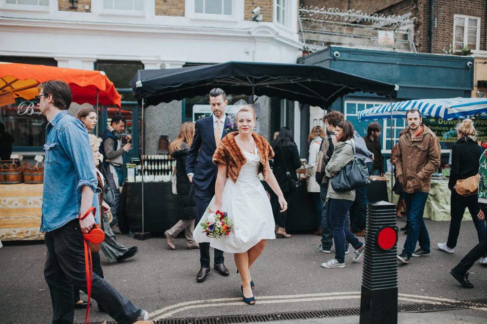bride wearing Vivienne Westwood dress Broadway Market reportage wedding