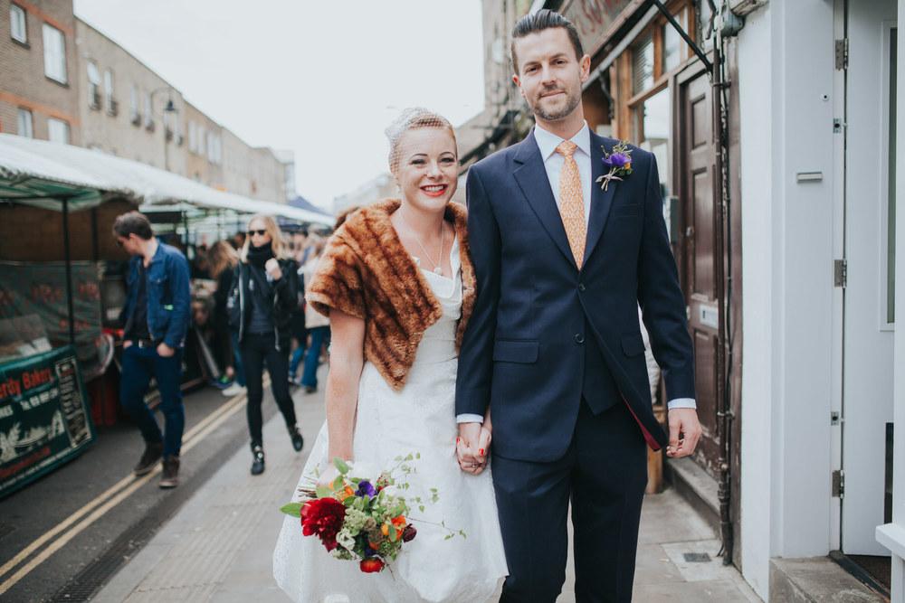 groom walking bride wedding portrait London