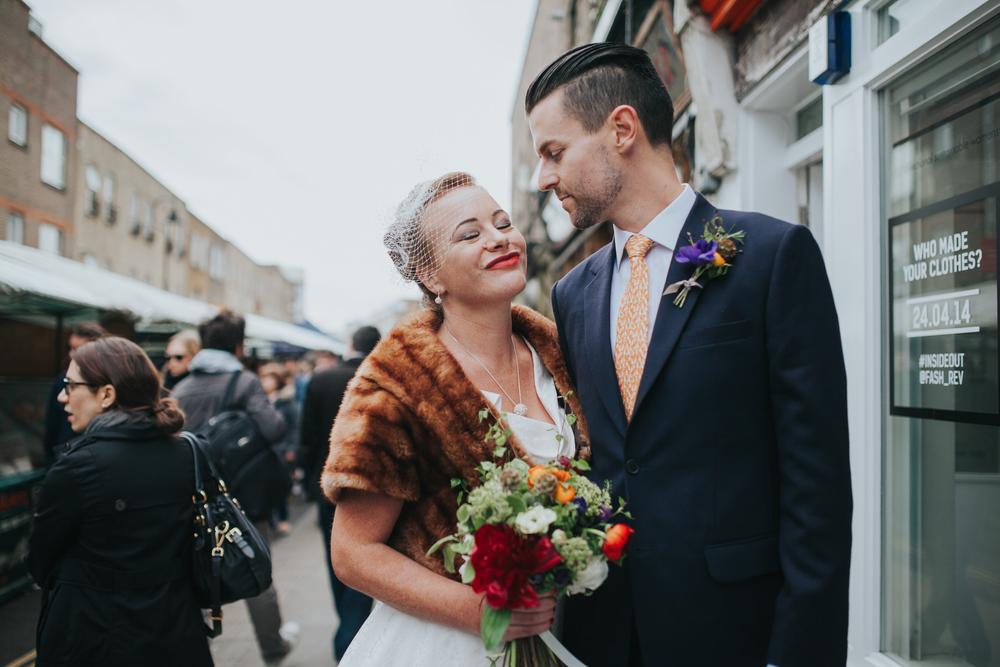 MS-Londesborough-Pub-wedding-Hackney-alternative-photographer-35-wedding-portraits-Broadway-market-quirky-couple-kissing.jpg