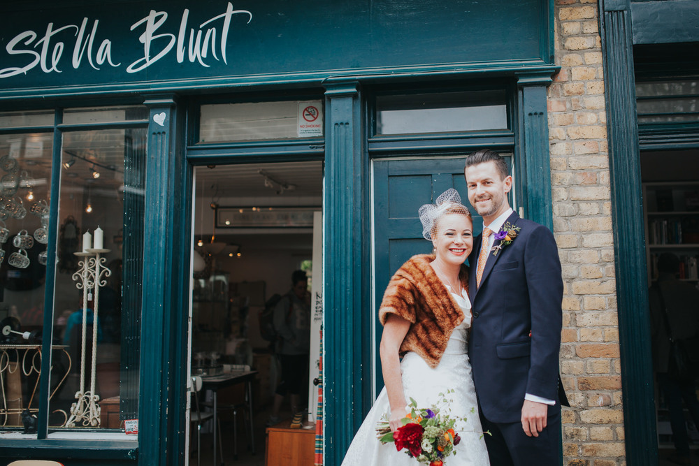 MS-Londesborough-Pub-wedding-Hackney-alternative-photographer-36-wedding-portraits-Broadway-market-quirky-couple-outside-Stella-Blunt-shop.jpg