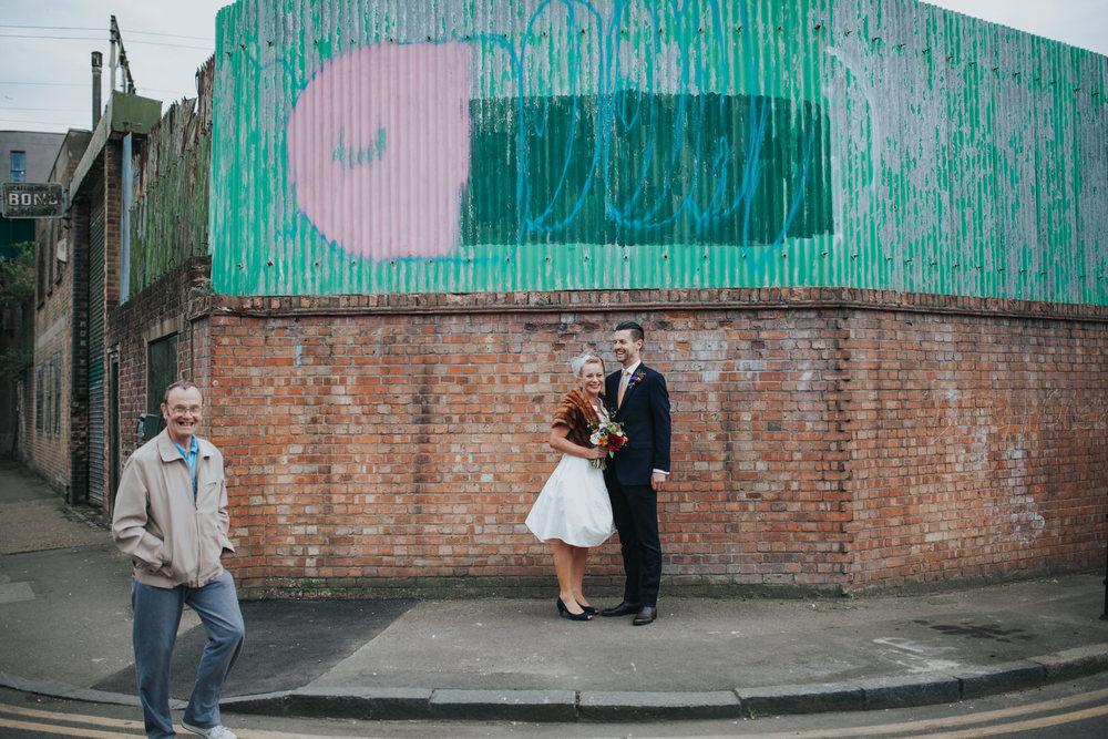 MS-Londesborough-Pub-wedding-Hackney-alternative-photographer-49-London-East-End-wedding-quirky-bride-groom-grafitti-photobomb.jpg