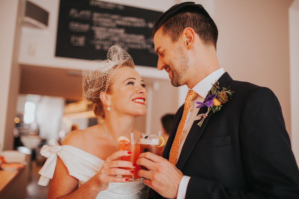 MS-Londesborough-Pub-wedding-Hackney-alternative-photographer-66-bride-drinking-cocktails-Ritas-London.jpg