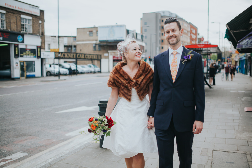 MS-Londesborough-Pub-wedding-Hackney-alternative-photographer-70-bride-walking-down-main-road-first-look.jpg