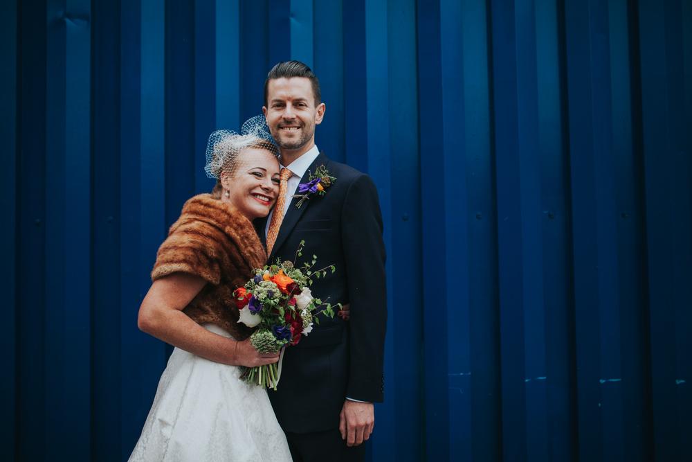MS-Londesborough-Pub-wedding-Hackney-alternative-photographer-80-bright-blue-metal-background-urban-wedding-portrait-bride-groom-under-railway-bridge.jpg