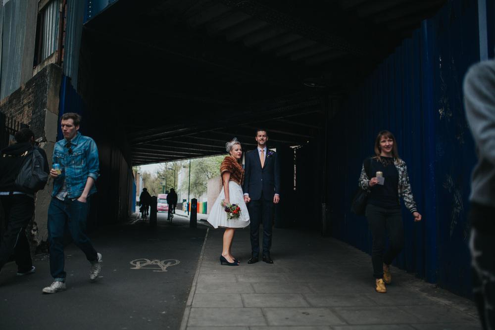 MS-Londesborough-Pub-wedding-Hackney-alternative-photographer-81-bright-blue-metal-background-urban-wedding-portrait-bride-groom-under-railway-bridge.jpg