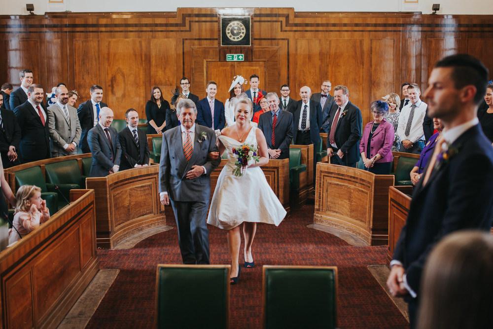 MS-Londesborough-Pub-wedding-Hackney-alternative-photographer-101-dad-walking-bride-down-aisle.jpg