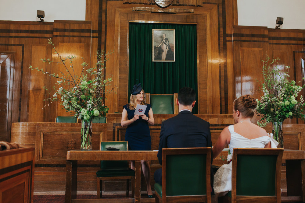 MS-Londesborough-Pub-wedding-Hackney-alternative-photographer-107-reading-during-marriage-ceremony.jpg