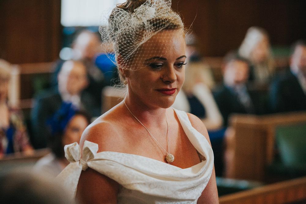 MS-Londesborough-Pub-wedding-Hackney-alternative-photographer-110-portrait-of-alternative-bride-during-marriage-ceremony.jpg