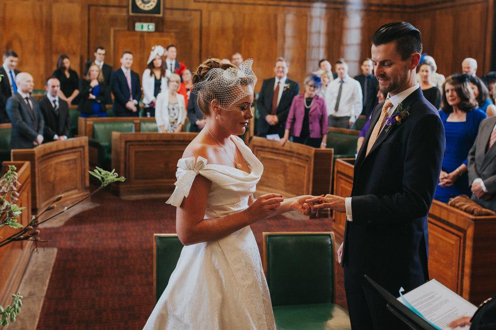 MS-Londesborough-Pub-wedding-Hackney-alternative-photographer-114-quirky-bride-exchanging-rings-groom.jpg