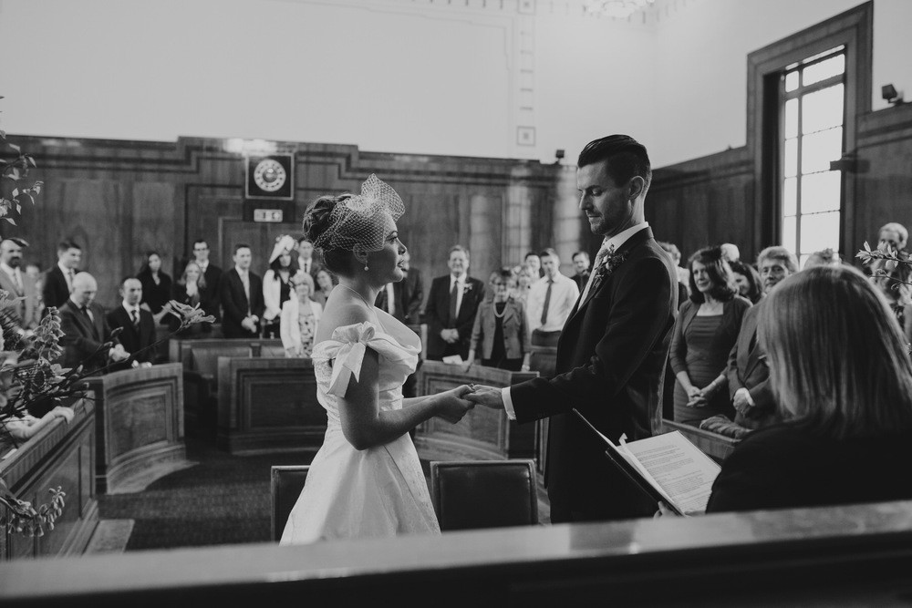 MS-Londesborough-Pub-wedding-Hackney-alternative-photographer-116-BW-bride-groom-exchanging-rings.jpg