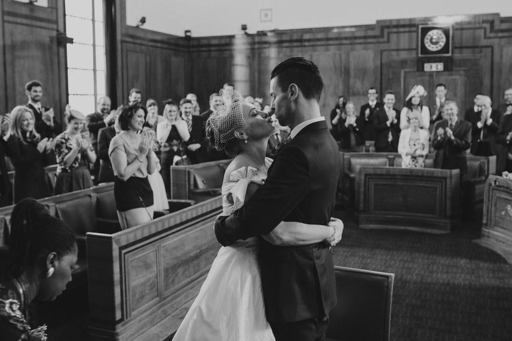 MS-Londesborough-Pub-wedding-Hackney-alternative-photographer-118-bride-groom-kiss-BW.jpg
