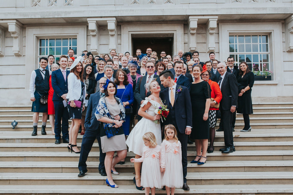 MS-Londesborough-Pub-wedding-Hackney-alternative-photographer-134-gratuitious-group-photo-stairs-town-hall.jpg