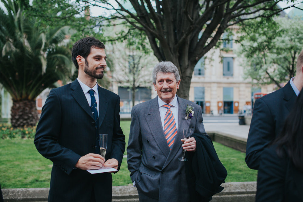 MS-Londesborough-Pub-wedding-Hackney-alternative-photographer-142-guests-drinking-bubbly-red-london-wedding-bus.jpg