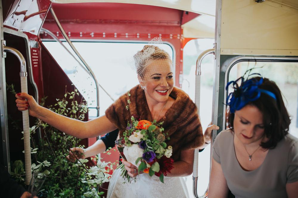 MS-Londesborough-Pub-wedding-Hackney-alternative-photographer-147-newly-married-bride-drinking-bubbly-red-london-wedding-bus.jpg