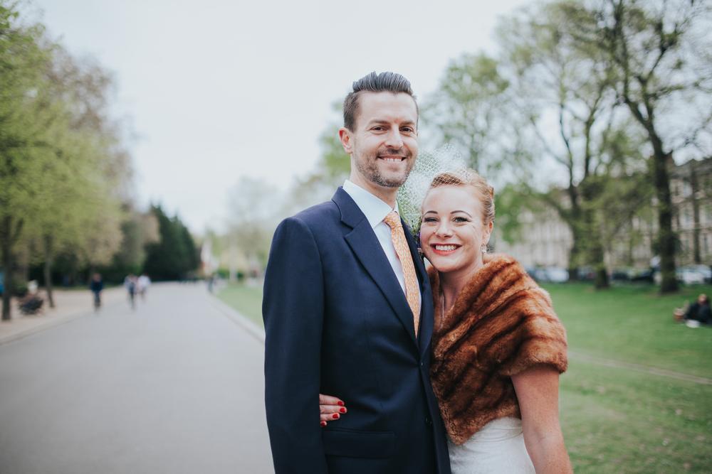 MS-Londesborough-Pub-wedding-Hackney-alternative-photographer-151-stylish-bride-wearing-white-birdcage-veil-brown-fur-stole.jpg