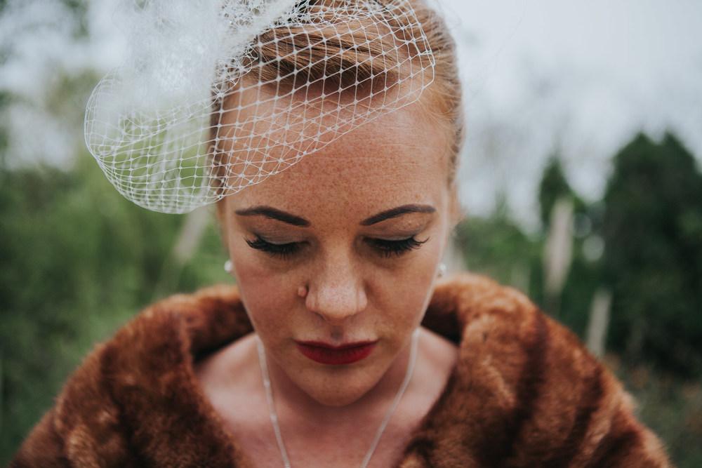 MS-Londesborough-Pub-wedding-Hackney-alternative-photographer-169-stylish-bride-wearing-white-birdcage-veil-brown-fur-stole.jpg