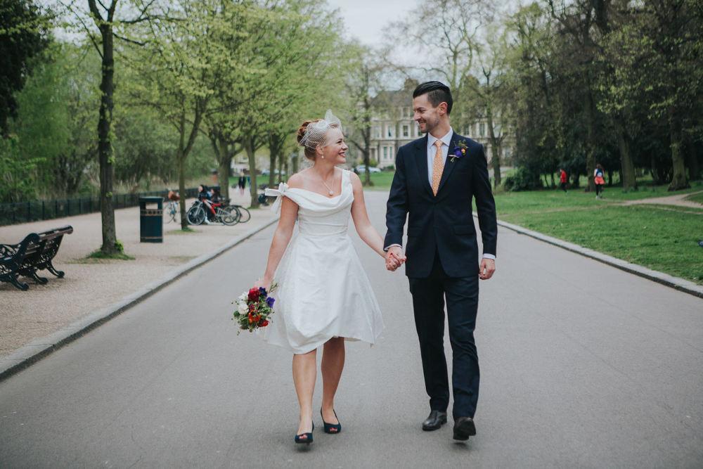 176-Hackney-alternative-wedding-photographer-couple-holding-hands.jpg