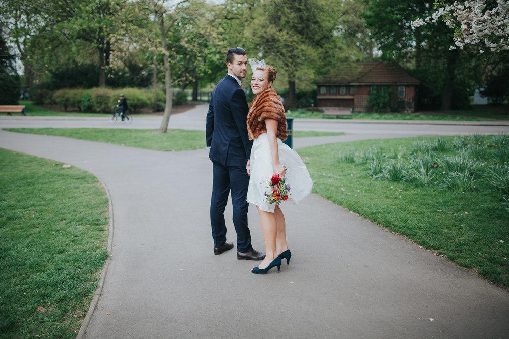 205-Victoria-park-alternative-wedding-couple-walking.jpg