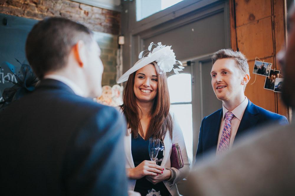227-Londesborough-Pub-wedding-guests-drinking-sparkling-wine.jpg