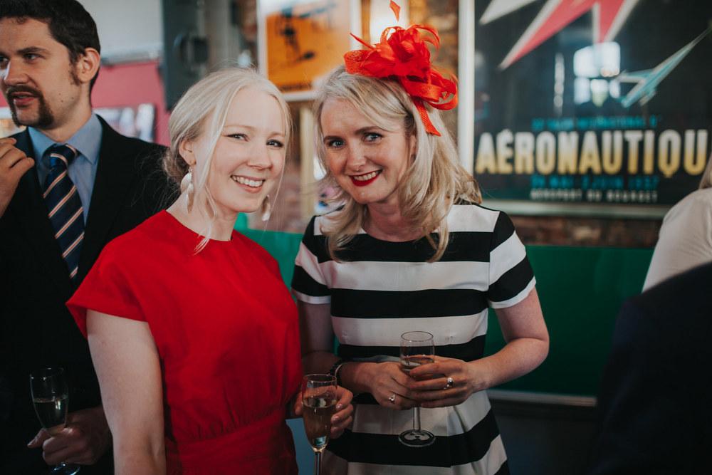 229-Londesborough-Pub-wedding-guests-red-hat.jpg