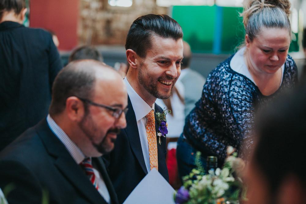 237-Londesborough-Pub-wedding-groom-laughing.jpg
