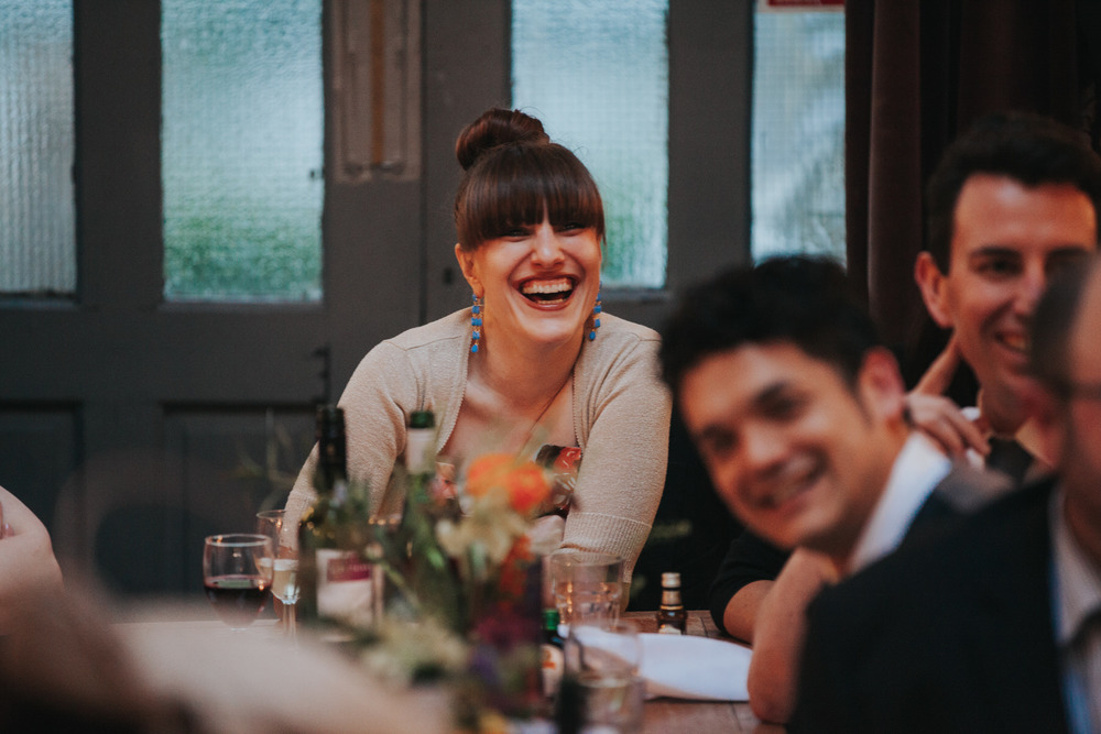 273-Londesborough-Pub-wedding-laughing-guests.jpg