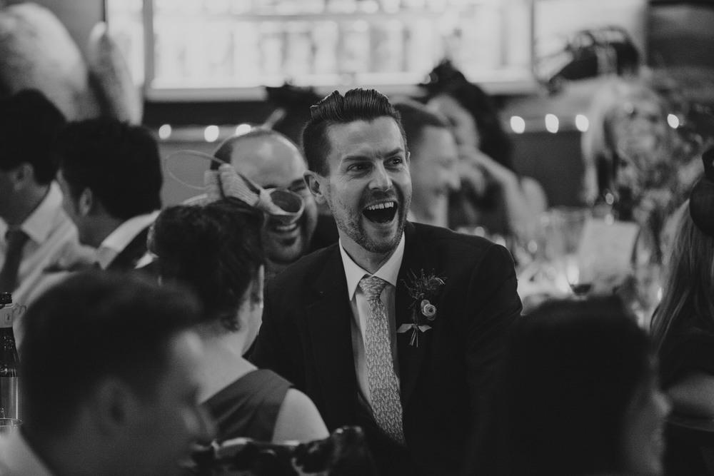 287-Londesborough-Pub-wedding-groom-laughing-reportage.jpg