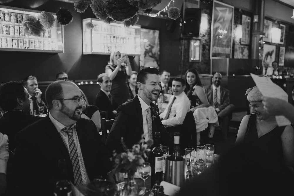 293-Londesborough-Pub-wedding-groom-laughing.jpg
