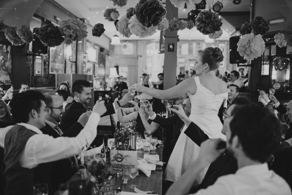 295-Londesborough-Pub-wedding-clinking-champagne-glasses.jpg