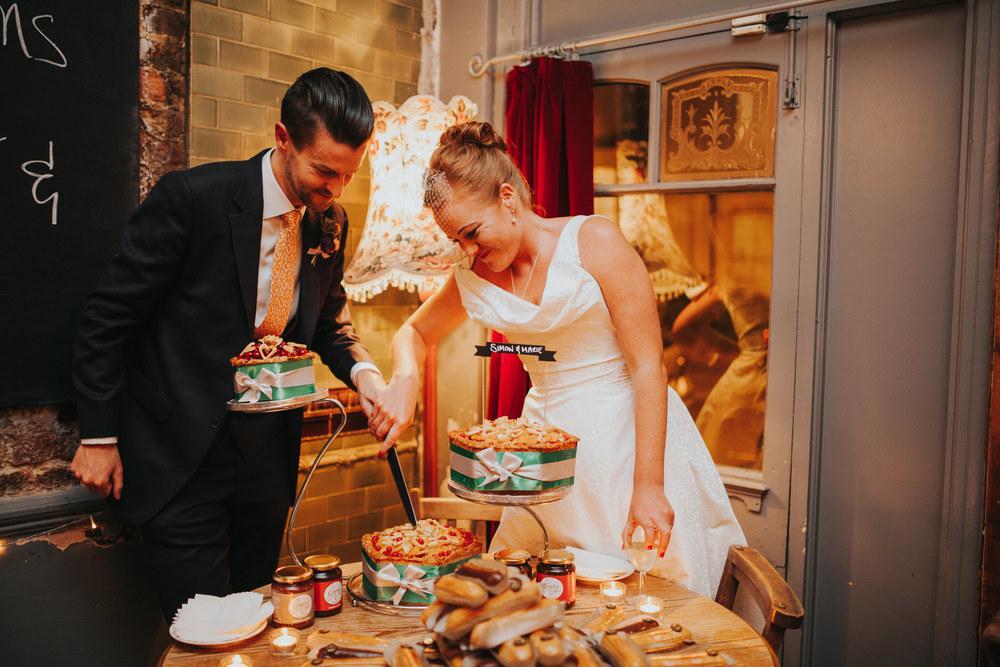 300-Londesborough-Pub-wedding-cutting-pork-pie.jpg