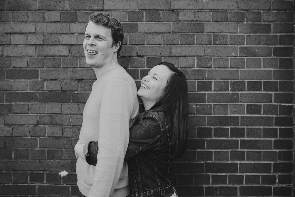 56-Quirky-engagement-London-modern-portrait-BW-brick-wall.jpg
