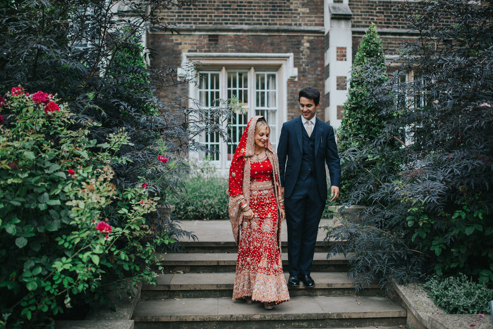 42-Anglo-Asian-London-Wedding-Middle-temple-bride-groom-walking-garden.jpg