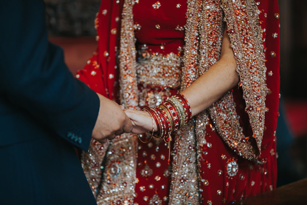83-Anglo-Asian-London-Wedding-Middle-temple-holding-hands-ceremony.jpg